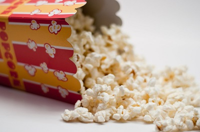 Container of Movie Popcorn in a Colorful Cardboard Box