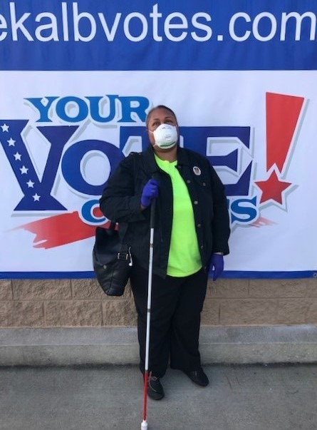 Empish Wearing Facemask and Gloves Standing Outside Voter Precinct After Voting in 2020 Presidential Election