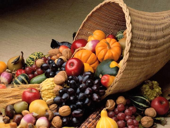 a Thanksgiving horn of plenty with a rainbow of fruits and vegetables