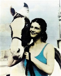 Color photo of Sonora Webster Carver posing with her horse