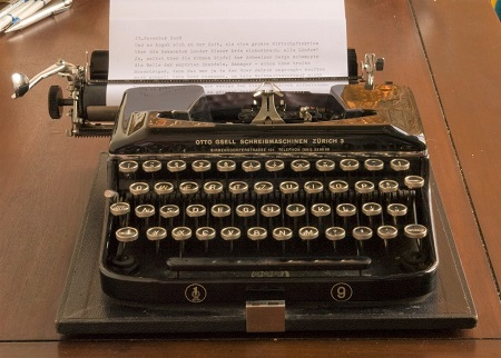 Vintage typewriter on a wooden desk