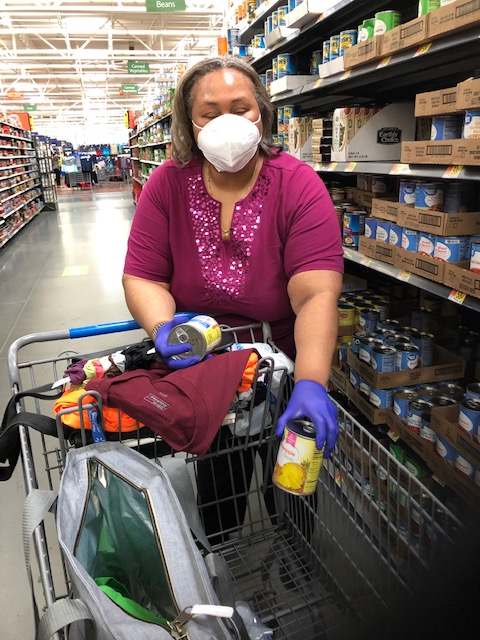 Empish grocery shopping wearing a facemask