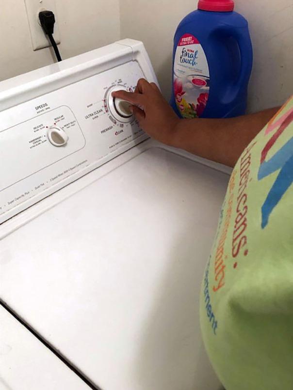 Empish touching dials on washing machine
