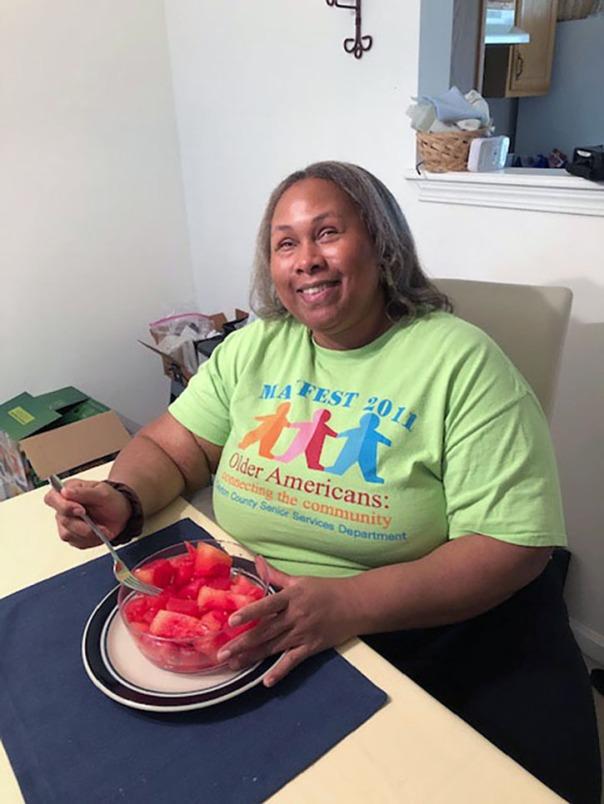 Empish eating a bowl of watermelon chunks